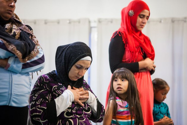 Naima (née Nancy) Carr, 29, seated in black hijab, and Jamila (née Daniela) Ortiz, 24, standing in red hijab, pray at the Masjid Al-Islam located in the Las Playas neighborhood of Tijuana. 'A lot of my family has stopped talking to me because of my religion,' said Carr who married an American convert but chose to follow Islam of her own volition after witnessing his dedication to ritual during Ramadan two years ago. -