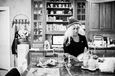 Donning a blond wig, Laurel Borowich did the dishes after dinner. Chappaqua, N.Y. February 2013.
