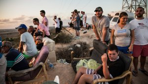 Issraelis gathered on a hilltop outside Sderot on Monday-AndrewBurton:Getty Images-NYT