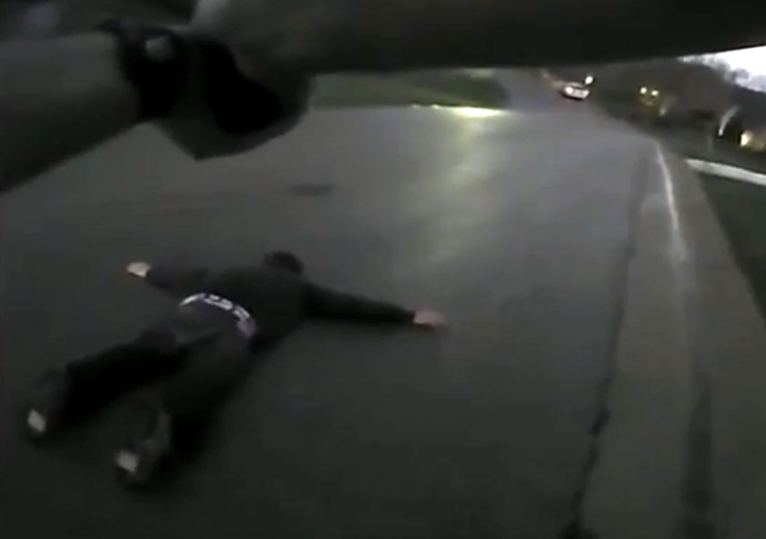 Michael Wilcox, 27, prone on the ground, unharmed