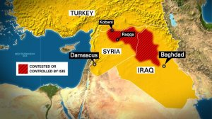 This map highlights the countries of Iraq, Syria and Turkey. Called out are the cities of Mosul and Kobani. The area of ISIS controlled or contested territory is highlighted in red.