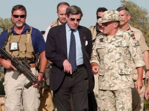 Paul Bremer, center who said ten years later: 'We made major strategic mistakes. But I still think Iraqis are far better off'