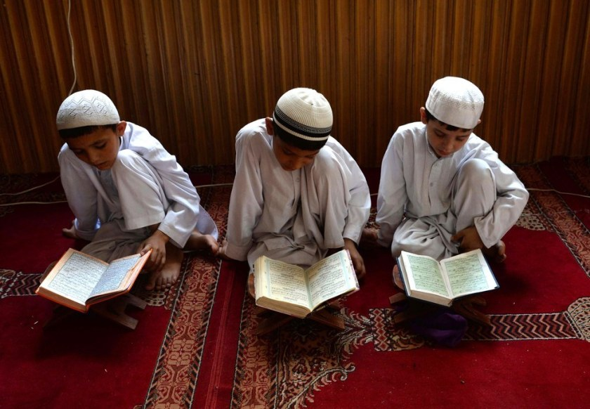 Afghan children study the Quran during first day of the month of Ramadan at a mosque in Jalalabad. Noorullah Shirzada / AFP / Getty Images