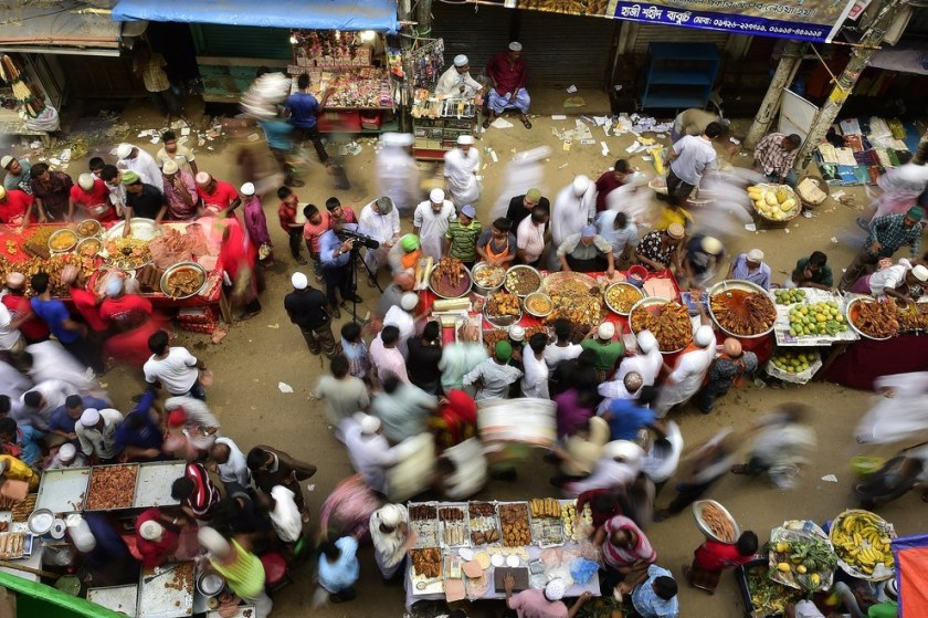 Bangladeshi street vendors prepare Iftar food for breaking the daytime fast on the first day of Ramadan, the holy fasting month of Islam, at a traditional bazaar in the old part of Dhaka. Munir Uz Zaman / Getty Images