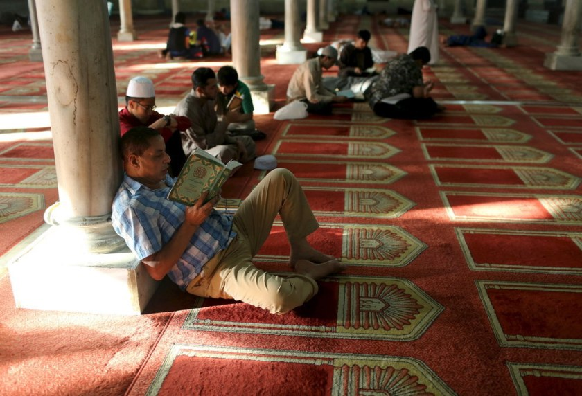 People read the Qur'an at a mosque during the first day of Ramadan in Cairo, Egypt. Asmaa Waguih / Reuters