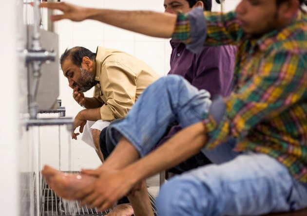 Men carry out Wudu, a washing procedure in preparation for prayer, at the East London Mosque before the first Friday prayers of the Islamic holy month of Ramadan in London, England. Rob Stothard / Getty Images
