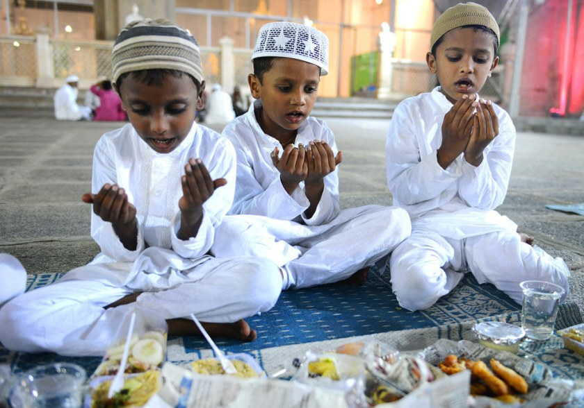 Indian Muslim boys offer prayers prior to breaking their fast on the first day of the Islamic holy month of Ramadan at Mecca Masjid in Hyderabad.  Noah Seelam / AFP / Getty Images