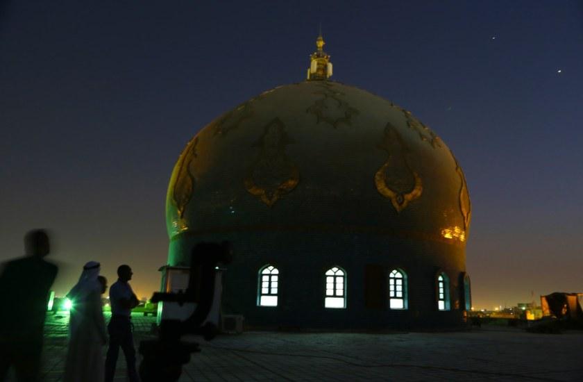 Iraqi Muslim men gather, on the roof of Imam Ali Mosque, waiting to see the crescent moon marking the beginning of Ramadan, at sunset in Basra, Iraq. Nabil Al-jurani / AP