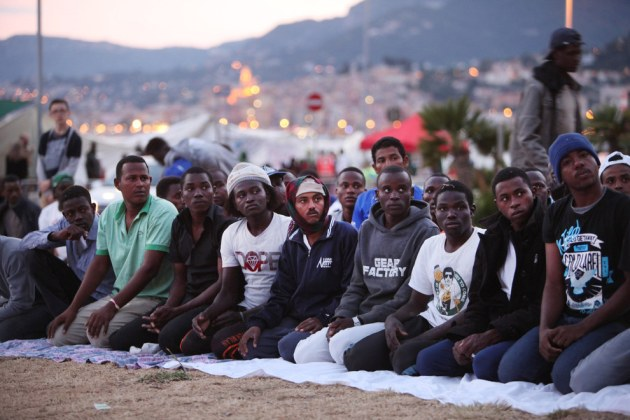 Migrants pray for the start of Ramadan as they gather at the French border hoping to enter the country in Ventimiglia, Italy. A group of around 200 migrants, mostly from Libya, Sudan and Eritrea, were left stranded at the border after French police refused them entry to the country. Patrick Aventurier / Getty Images