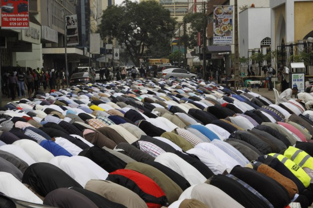 Kenyan Muslim men pray on the first Friday of Ramadan, at Jamia mosque in Nairobi, Kenya.  Khalil Senosi / AP