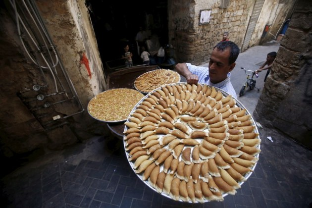 A vendor carries traditional sweets called 'Qatayef' during the Muslim fasting month of Ramadan in Sidon's Old City in southern Lebanon. Ali Hashisho / Reuters
