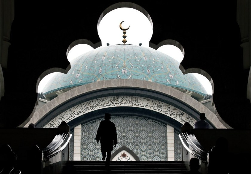 A Malaysian Muslim arrives to offer prayers on the first Friday of the holy Islamic month of Ramadan in Kuala Lumpur. Manan Vatsyayana / AFP / Getty Images