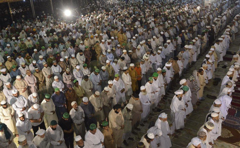 """Pakistani Muslims perform a special """"Taraweeh"""" evening prayer on the first day of Ramadan at a mosque in Lahore. Arif Ali / AFP / Getty Images"""