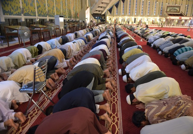 """Pakistani Muslims perform a special """"Taraweeh"""" evening prayer on the first day of Ramadan at the grand Faisal Mosque in Islamabad. Aamir Qureshi / AFP / Getty Images"""
