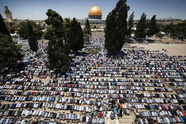 Palestinian Muslim worshipers pray outside the Dome of the Rock at the Al-Aqsa Mosque compound in Jerusalem during the first Friday prayer of the holy month of Ramadan. Israel announced it was relaxing restrictions on the movement of Palestinians to and from the West Bank and Gaza Strip, ahead of the Muslim holy month of Ramadan. Men aged over 40 and women of all ages from the West Bank will be able to pray at the Israeli-controlled holy site, and 800 people from the Gaza Strip will be allowed to attend Friday prayers.  Ahmad Gharabli / AFP / Getty Images