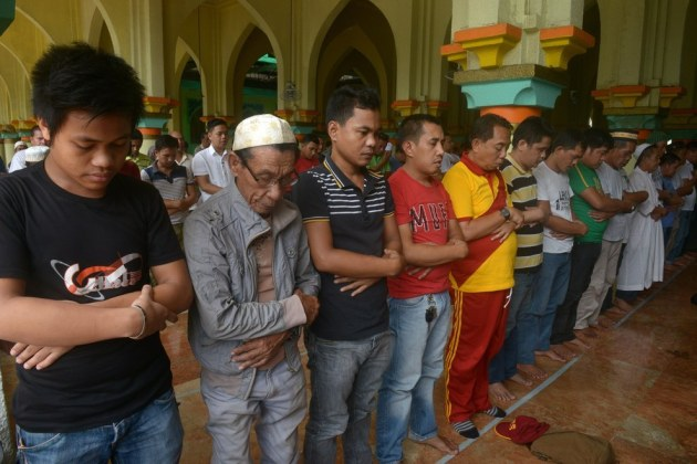 Filipino Muslims take part in prayers at the Golden Mosque in Manila. Jay Directo / AFP / Getty Images