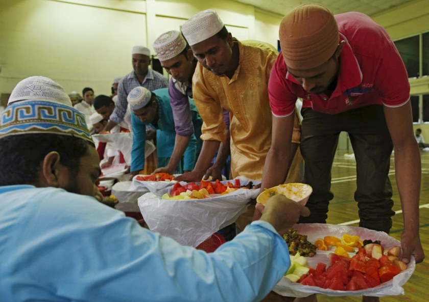 Bangladeshi workers prepare to break fast during the holy month of Ramadan at a makeshift mosque near their dormitory in Singapore. Edgar Su / Reuters