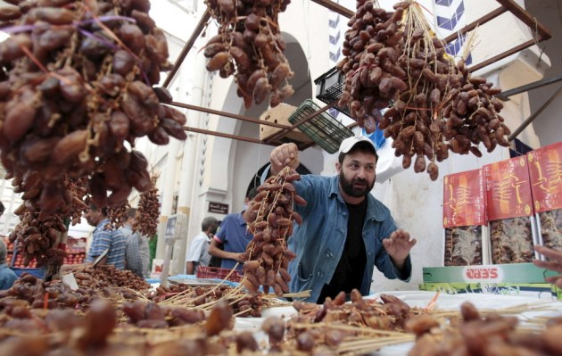 A vendor displays his dates on the first day of the Muslim holy fasting month of Ramadan, in a market downtown in Tunis, Tunisia. Zoubeir Souissi / Reuters