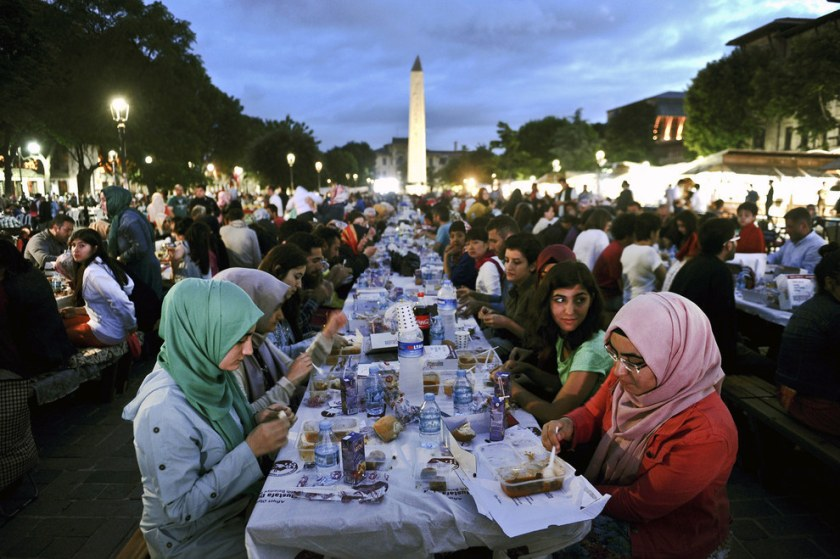 Thousands of Turkish people break their fasting at the Blue Mosque square in Istanbul, during the first day of the holy month of Ramadan. Ramadan is sacred to Muslims because it is during that month that tradition says the Qur'an was revealed to the Prophet Mohammed. The fast is one of the five main religious obligations under Islam. Ozan Kose / Getty Images