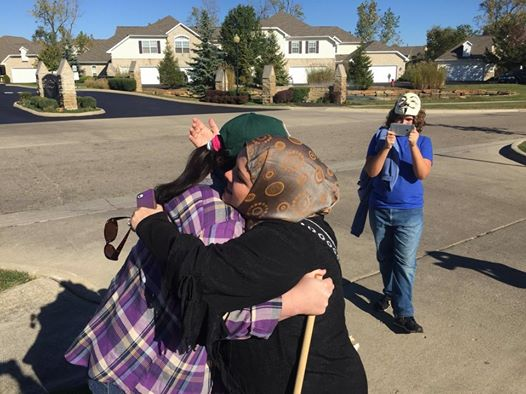 "Cynthia Cox de Boutinkhar hugs ""Annie"" an anti-Islam protestor at a Hilliard, Ohio masjid"